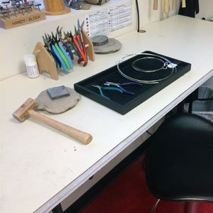 Wire wrapping setup on a jewelry bench