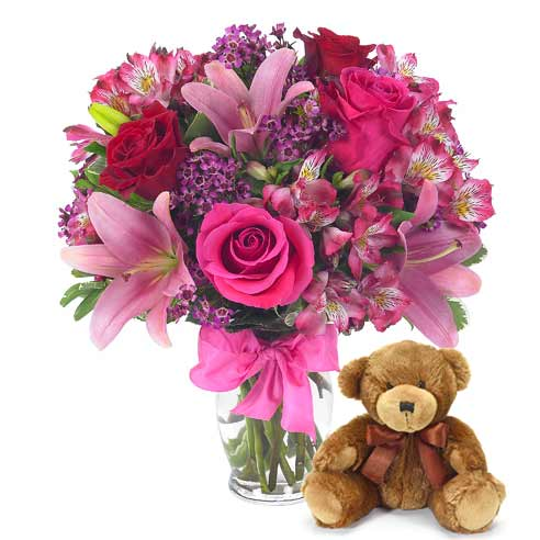 hot pink roses and pink alstroemeria flower bouquet with teddy bear