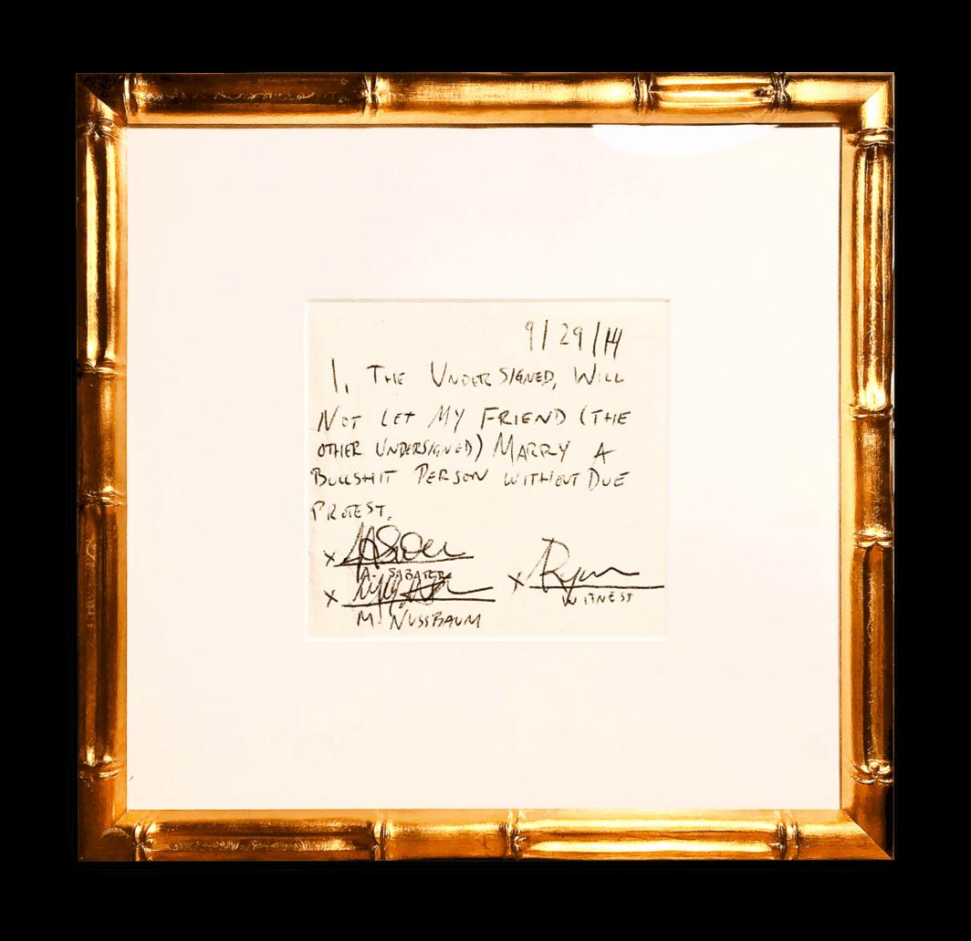 cocktail napkin framed in gold frame