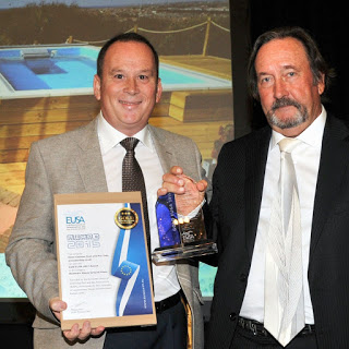 a U.K. Endless Pools dealer accepting an award for an Endless Pools installation