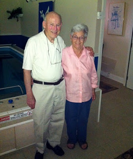 Ernie and Marge in front of their Endless Pools swimming machine